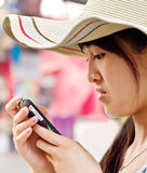 A girl  reading sms from a mobile Stock Photos