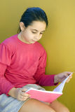 Girl reading on the stairs royalty free stock photos