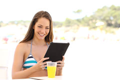 Girl reading a tablet or ebook on summer holidays Royalty Free Stock Image