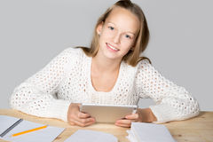 Girl reading with tablet Royalty Free Stock Image