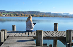 Girl reading from a tablet Stock Photography
