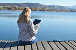Girl reading from a tablet Royalty Free Stock Photos