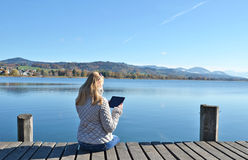 Girl reading from a tablet Stock Images