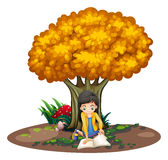A girl reading under the tree Royalty Free Stock Photo