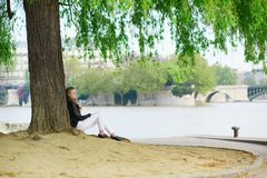 Girl reading under a tree Stock Image