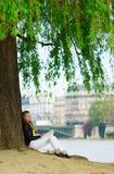 Girl reading under a tree Royalty Free Stock Images