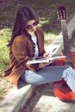 Girl reading in urban scene Royalty Free Stock Photos