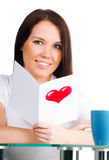 Girl is reading a valentine Stock Photography