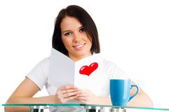 Girl is reading a valentine Stock Photo