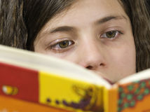 Girl that reads. Eyes of a girl who reads Stock Image