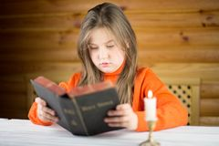 The girl reads the Bible Stock Images