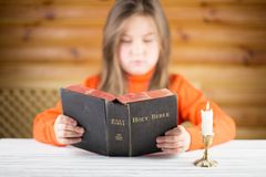 The girl reads the Bible Stock Photos