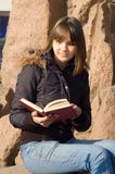 The girl reads the book. In park royalty free stock photography