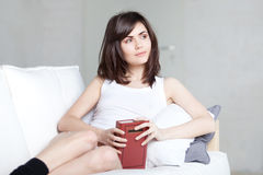Girl reads book Stock Images
