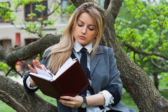 Girl reads the book Stock Photography