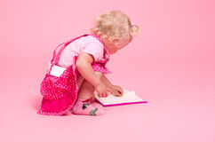 Girl  reads the book Royalty Free Stock Photo