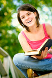 Girl reads book Stock Image