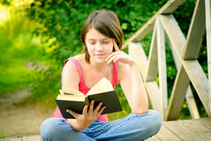 Girl reads book Stock Photos