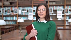 Girl Reads the Book stock video footage