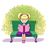 A girl reads a book Royalty Free Stock Images