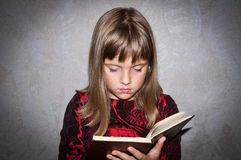 Girl reads book. Teen girl reads book - interested Royalty Free Stock Image
