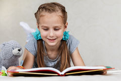 The girl reads the book Stock Images