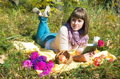 The girl reads outdoors Stock Photos
