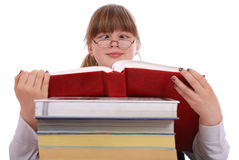 The girl reads the red book. Cross-eyed Stock Photos