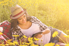 Girl reads a tablet into nature Stock Photos