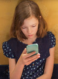 A girl reads the text message Royalty Free Stock Photography