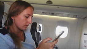 The girl reads the text on your smartphone stock footage