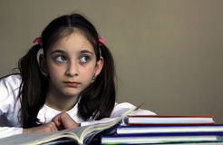 Girl reads and thinks Royalty Free Stock Image