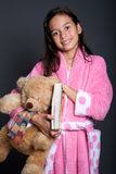 girl ready for bed with book and teddy Stock Photography