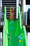 Girl ready to slide Stock Images