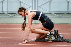 Girl  ready to start running on running track Royalty Free Stock Photography