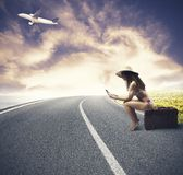 Girl ready to travel. Concept of girl ready to travel with airplane Stock Images