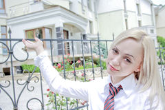 Girl realtor shows the house. The beautiful girl realtor shows the house Royalty Free Stock Photos