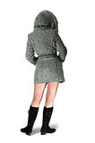Girl rear in gray coat. Woman in gray coat and black high shoes Royalty Free Stock Photography