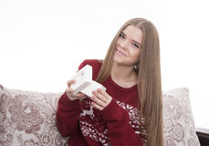 Girl  received a gift. Girl opens a Christmas present Royalty Free Stock Photos
