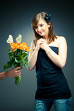 Girl receives flowers Stock Photography