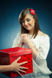 Girl receives a gift Royalty Free Stock Photography