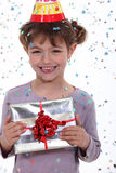 Girl receiving birthday present Stock Images