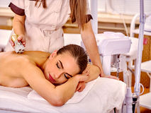 Girl receiving electric massage at beauty salon Stock Photo