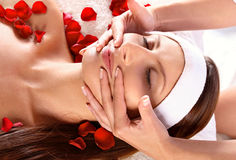 Girl receiving facial massage Royalty Free Stock Images