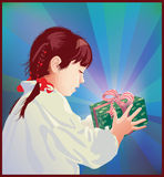 Girl receiving a gift Royalty Free Stock Image
