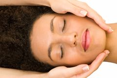 Girl receiving head massage Royalty Free Stock Photography