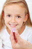 Girl receiving homeopathic medication Stock Images