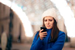 Girl Receiving Inappropriate Text Messages on Christmas Time. Funny woman reading awkward sms she received royalty free stock image