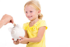 Girl receiving money Royalty Free Stock Photos