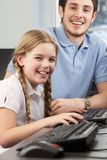 Girl receiving one to one help from teacher Stock Image
